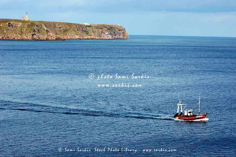 Fishing boat navigating around the Cap Frehel peninsula, Brittany, France.