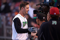 Dayton Dragons catcher Garrett Boulware (30) is congratulated by teammates after hitting a home run during a game against the Great Lakes Loons on May 21, 2015 at Fifth Third Field in Dayton, Ohio.  Great Lakes defeated Dayton 4-3.  (Mike Janes/Four Seam Images)