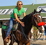 Churchill Downs' Racing Analyst Jill Byrne gives Lava Man, a retired thoroughbred race horse and earner of more than $5,000,000, a hug during morning workouts for the Kentucky Derby and Kentucky Oaks at Churchill Downs in Louisville, Kentucky on April 30, 2012.