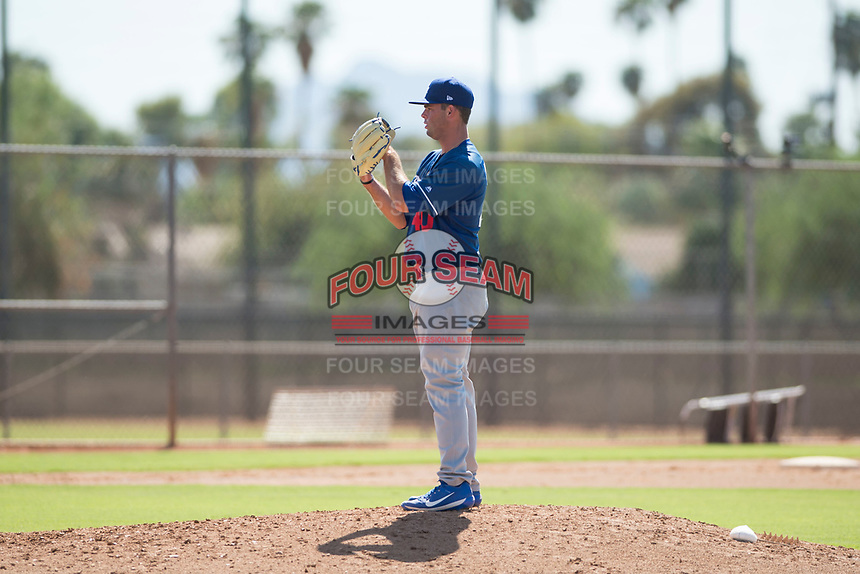 Los Angeles Dodgers relief pitcher Bryan Warzek (40) looks in for the sign during an Instructional League game against the Milwaukee Brewers at Maryvale Baseball Park on September 24, 2018 in Phoenix, Arizona. (Zachary Lucy/Four Seam Images)