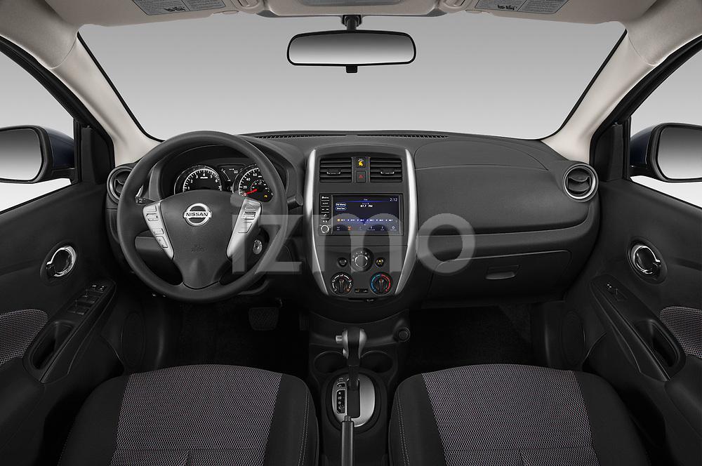 Stock photo of straight dashboard view of 2019 Nissan Versa-Sedan SV 4 Door Sedan Dashboard