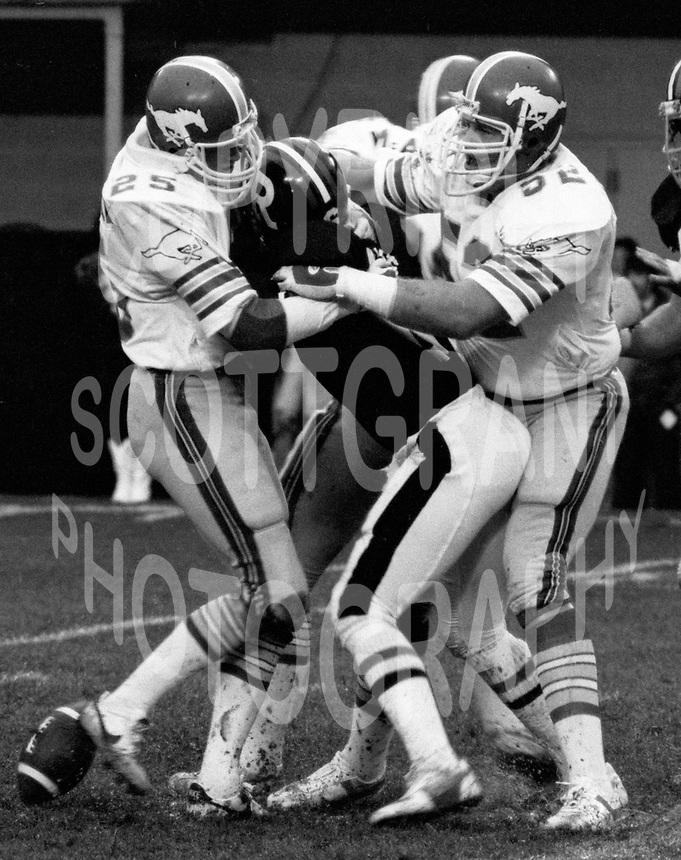 Doug Battershill, Bob Waite, Calgary Stampeders. Photo F. Scott Grant.
