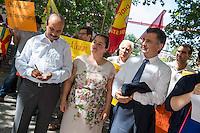 """Kundgebung von Mitgliedern der tuerkischen Partei HDP und Kurden vor dem Auswaertigen Amt in Berlin.<br /> Am Donnerstag den 6. August 2015 protestierten Mitglieder der tuerkischen Partei HDP und Kurden vor dem Auswaertigen Amt in Berlin gegen die fortdauernden Angriffe des tuerkischen Militaers gegen Kurden in der Tuerkei, Syrien und dem Irak.<br /> An der Kundgebung nahemn auch die Bundestagsabgeordnete der Linkspartei, Sevim Dagdelen, der HDP-Abgeordnete aus der kurdischen Stadt Diybakir, Ziya Pir und der Vorsitzende desdeutsch-kurdischen Verein Nav-Dem, Yuksel Koc teil. Die Kundgebungsteilnehmer riefen unter anderem Parolen """"Deutsche Panzer raus aus Kurdistan"""" und Freiheit fuer Rojava - der autonomen kurdischen Region in Syrien.<br /> Im Bild vlnr.: Yuksel Koc; Sevim Dagdelen; Ziya Pir.<br /> 6.8.2015, Berlin<br /> Copyright: Christian-Ditsch.de<br /> [Inhaltsveraendernde Manipulation des Fotos nur nach ausdruecklicher Genehmigung des Fotografen. Vereinbarungen ueber Abtretung von Persoenlichkeitsrechten/Model Release der abgebildeten Person/Personen liegen nicht vor. NO MODEL RELEASE! Nur fuer Redaktionelle Zwecke. Don't publish without copyright Christian-Ditsch.de, Veroeffentlichung nur mit Fotografennennung, sowie gegen Honorar, MwSt. und Beleg. Konto: I N G - D i B a, IBAN DE58500105175400192269, BIC INGDDEFFXXX, Kontakt: post@christian-ditsch.de<br /> Bei der Bearbeitung der Dateiinformationen darf die Urheberkennzeichnung in den EXIF- und  IPTC-Daten nicht entfernt werden, diese sind in digitalen Medien nach §95c UrhG rechtlich geschuetzt. Der Urhebervermerk wird gemaess §13 UrhG verlangt.]"""