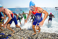 16 SEP 2012 - NICE, FRA - Alberto Casadei of Rouen Triathlon leaves the water at the end of the swim during the final stage of the French Grand Prix triathlon series held during the Triathlon de Nice Côte d'Azur (PHOTO (C) 2012 NIGEL FARROW)