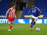 16th March 2021; Cardiff City Stadium, Cardiff, Glamorgan, Wales; English Football League Championship Football, Cardiff City versus Stoke City; Sheyi Ojo of Cardiff City moves forward with the ball as Joe Allen of Stoke City pressures from behind