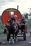 Irish Travellers   family southern Ireland with traditional horse drawn caravan. Eire. 1970s.<br /> Traditional Bow top wagon.
