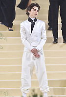 """NEW YORK, NEW YORK - SEPTEMBER 13: Timothe'e Chalamet at the 2021 Met Gala benefit """"In America: A Lexicon of Fashion"""" at Metropolitan Museum of Art on September 13, 2021 in New York City. Credit: John Palmer/MediaPunch"""