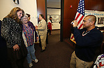 Amy Roby, project manager of the Always Lost: A Meditation on War exhibit poses with Navy veteran Ellie Hays and her godson Marine Master Sgt. Carlos Candido at the Legislative Building in Carson City, Nev., on Monday, April 6, 2015. <br />