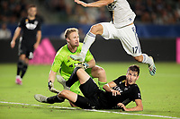 CARSON, CA - SEPTEMBER 15: Sporting Kansas City's Tim Melia #29 and Graham Smith #16 try to avoid being hit by in coming Sebastian Lletget #17 of the Los Angeles Galaxy during a game between Sporting Kansas City and Los Angeles Galaxy at Dignity Health Sports Complex on September 15, 2019 in Carson, California.