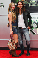 WESTWOOD, LOS ANGELES, CA, USA - AUGUST 03: Emily Johnson, Zach McGowan at the Los Angeles Premiere Of Paramount Pictures' 'Teenage Mutant Ninja Turtles' held at Regency Village Theatre on August 3, 2014 in Westwood, Los Angeles, California, United States. (Photo by Celebrity Monitor)