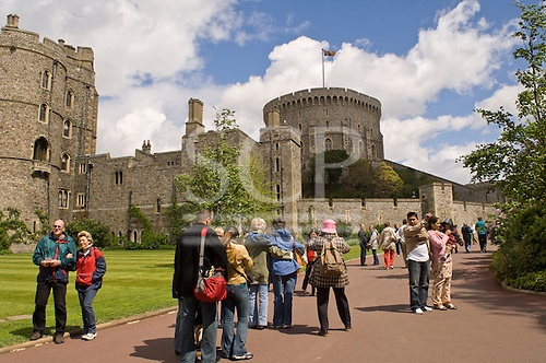 Windsor Castle, Royal Windsor, Berkshire. Tourists of many nationalities visiting the castle, outside.