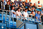 Kilmarnock fans practising safe standing in the rail seating area of the East Stand at Rugby Park. The ground has room for 324 fans to 'safe stand' in the East and South Stands. Celtic Park is the only other Scottish ground to experiment with a safe standing area. Kilmarnock 2 Ayr United 0, Scottish Championship, August 2nd 2021. Following Kilmarnock's relegation in 2020-21, the first game of the new season is the Ayreshire Derby, the first league match between the teams in 28 years. Due to relaxation of Covid restrictions the match was played in front of a crowd of 3200 Kilmarnock fans. The game was shown live on BBC Scotland.
