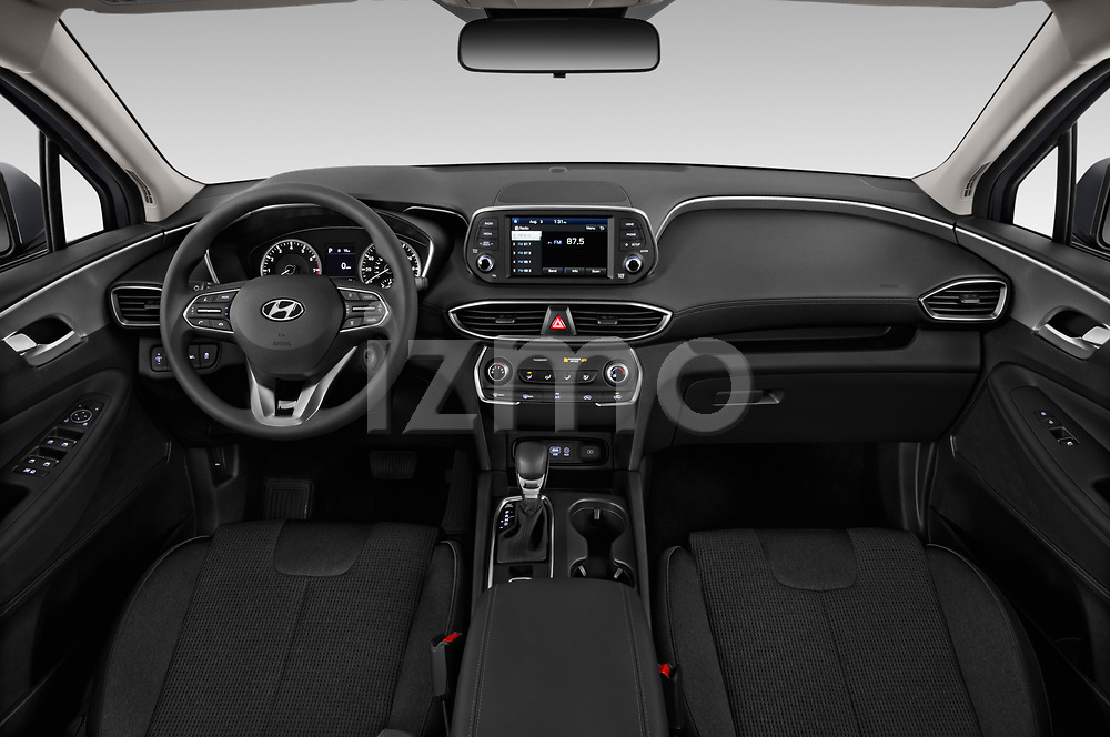 Stock photo of straight dashboard view of 2020 Hyundai Santa-FE SE 5 Door SUV Dashboard