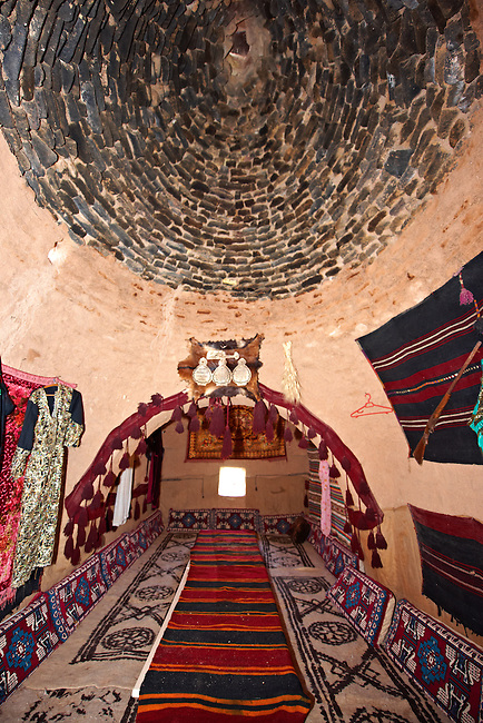 """Pictures of the beehive adobe buildings of Harran, south west Anatolia, Turkey.  Harran was a major ancient city in Upper Mesopotamia whose site is near the modern village of Altınbaşak, Turkey, 24 miles (44 kilometers) southeast of Şanlıurfa. The location is in a district of Şanlıurfa Province that is also named """"Harran"""". Harran is famous for its traditional 'beehive' adobe houses, constructed entirely without wood. The design of these makes them cool inside. 7"""
