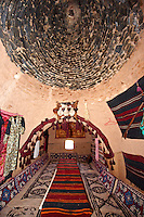 "Pictures of the beehive adobe buildings of Harran, south west Anatolia, Turkey.  Harran was a major ancient city in Upper Mesopotamia whose site is near the modern village of Altınbaşak, Turkey, 24 miles (44 kilometers) southeast of Şanlıurfa. The location is in a district of Şanlıurfa Province that is also named ""Harran"". Harran is famous for its traditional 'beehive' adobe houses, constructed entirely without wood. The design of these makes them cool inside. 7"