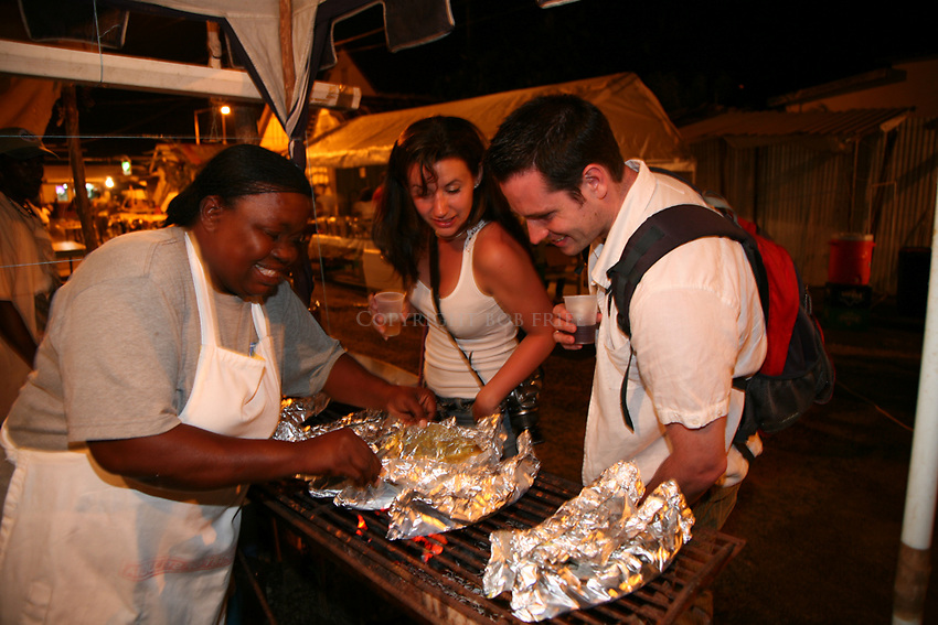Friday night fish fry at the fishing village of Anse La Raye, St. Lucia, with Sophia Minvielle's fish, hot bakes and rum booth.