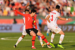 Son Heungmin of South Korea (C) fights for the ball with Sayed Dhiya Saeed of Bahrain (L) and Waleed Mohamed Alhayam of Bahrain (R) during the AFC Asian Cup UAE 2019 Round of 16 match between South Korea (KOR) and Bahrain (BHR) at Rashid Stadium on 22 January 2019 in Dubai, United Arab Emirates. Photo by Marcio Rodrigo Machado / Power Sport Images