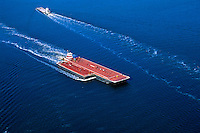 Aerial view of barges and a tugboat.