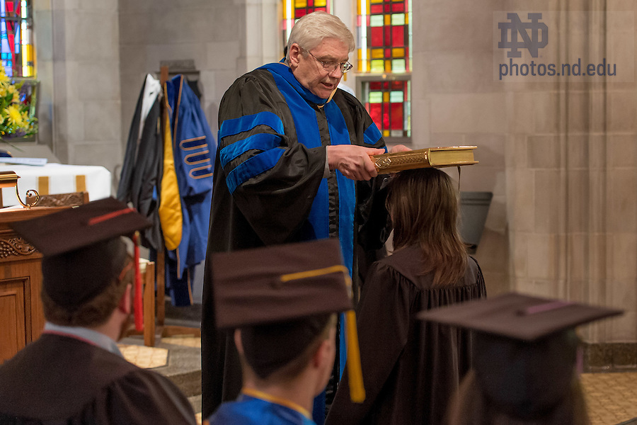 May 14, 2016; John Van Engen, Director of the Medieval Institue, touches the heads of graduates with a Gospel Book during the Medieval Institute graduation ceremony in the Alumni Hall chapel. (Photo by Matt Cashore/University of Notre Dame)