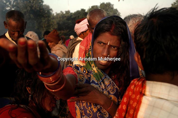 An Indian woman prays to Sun god during Sonepur fair. Bihar, India, Arindam Mukherjee