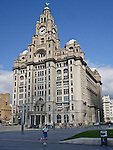 A jogger runs past The Royal Liver Building in Liverpool