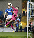 Lewis Macleod knocks the ball and the keeper into the net