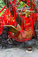 Guilin, China.  Elephant Trunk Hill Park.  Chinese Phoenix Surrounded by Red Ribbons Requesting a Wish.