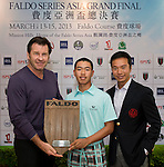 Guan Tianlang (centre) of China receives a Faldo Series Special Achievement Award from Sir Nick Faldo (left) during the 7th Faldo Series Asia Grand Final at Mission Hills Golf Club in Shenzhen, China. Photo by Andy Jones / The Power of Sport Images