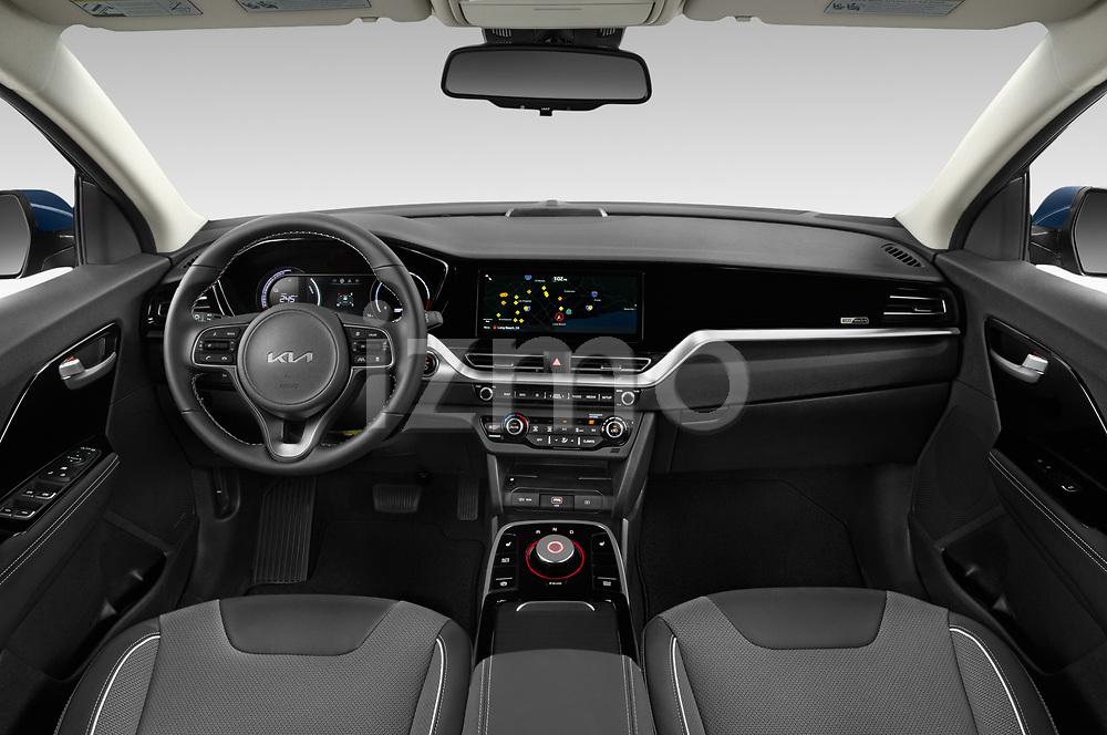 Stock photo of straight dashboard view of 2022 KIA Niro-EV EX 5 Door Hatchback Dashboard