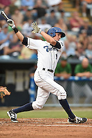 Asheville Tourists right fielder Jordan Patterson #10 swings at a pitch during a game against the Savannah Sand Gnats at McCormick Field September 3, 2014 in Asheville, North Carolina. The Tourists defeated the Sand Gnats 8-3. (Tony Farlow/Four Seam Images)