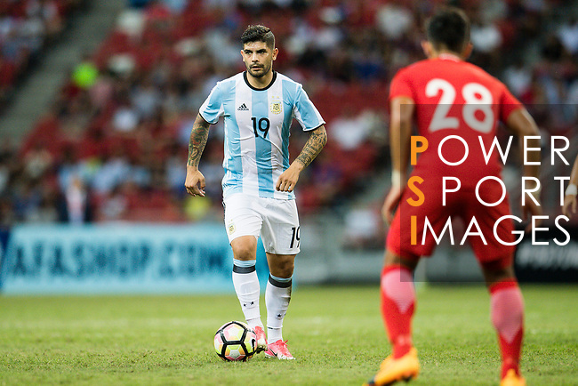 Ever Banega of Argentina (L) in action during the International Test match between Argentina and Singapore at National Stadium on June 13, 2017 in Singapore. Photo by Marcio Rodrigo Machado / Power Sport Images
