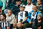 A Newcastle fan sporting a black and white striped hard hat. Newcastle v West Ham, August 15th 2021. The first game of the season, and the first time fans were allowed into St James Park since the Coronavirus pandemic. 50,673 people watched West Ham come from behind twice to secure a 2-4 win.