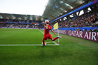 REIMS,  - JUNE 11: Megan Rapinoe #15 takes a corner kick during a game between Thailand and USWNT at Stade Auguste Delaune on June 11, 2019 in Reims, France.