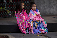 People in Mexico city wait in the streets after evacuating their homes due a new eartquake with center in southern region  of  Oaxaca. Two earlier quakes killed hundreds of people and turned buildings into dust and debris in parts of Mexico. More than 300 people have been reported killed in Tuesday's quake; nearly 100 reportedly died in the September 8 temblor.