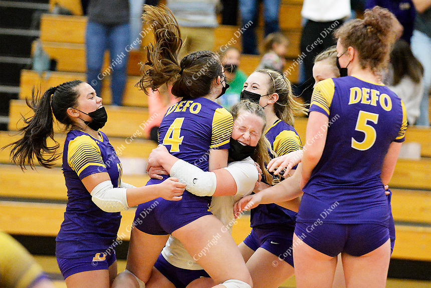 DeForest celebrates victory as they top Waunakee 3 sets to 1 in Wisconsin WIAA girls high school volleyball regional finals on Saturday, Apr. 10, 2021 at DeForest High School
