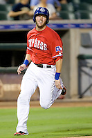 Round Rock Express first baseman Chad Tracy #28 rounds third base and heads home to score during a game against the New Orleans Zephyrs at the Dell Diamond on July 20, 2011 in Round Rock, Texas.  New Orleans defeated Round Rock 14-11.  (Andrew Woolley/Four Seam Images)