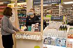 Angela Brosnan working in Brosnans pharmacy in Kenmare