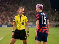 AUSTIN, TX - JUNE 16: Refereee Katja Koroleva talks to Megan Rapinoe #15 of the USWNT during a game between Nigeria and USWNT at Q2 Stadium on June 16, 2021 in Austin, Texas.