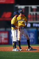 Michigan Wolverines Jimmy Kerr (15) talks with assistant head coach Nick Schnabel (23) during a game against Army West Point on February 17, 2018 at Tradition Field in St. Lucie, Florida.  Army defeated Michigan 4-3.  (Mike Janes/Four Seam Images)