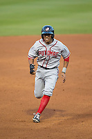 Christopher Bostick (11) of the Potomac Nationals hustles towards third base against the Winston-Salem Dash at BB&T Ballpark on April 30, 2015 in Winston-Salem, North Carolina.  The Nationals defeated the Dash 5-4..  (Brian Westerholt/Four Seam Images)