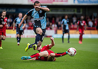 Michael Harriman of Wycombe Wanderers gets past Christian Scales of Crawley Town during the Sky Bet League 2 match between Crawley Town and Wycombe Wanderers at Checkatrade.com Stadium, Crawley, England on 29 August 2015. Photo by Liam McAvoy.