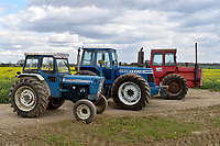 BNPS.co.uk (01202) 558833. <br /> Pic: Cheffins/BNPS<br /> <br /> Pictured (from left): A Ford 7000 sold for £34,840, a 1983 County 1474 sold for £210,112 and a 1974 Massey Ferguson 1200 sold for 27,872. <br /> The top selling lot was a 1983 County 1474 (PICTURED CENTRE) which has done less than 100 hours in the past 25 years. It fetched £210,100<br /> <br /> <br /> A farming family is today celebrating after their incredible collection of almost 100 vintage tractors sold for a staggering £1million.<br /> <br /> Father and son duo Ian and Martin Liddell began hoarding the agricultural vehicles at their arable farm in the 1980s.<br /> <br /> Their fleet of tractors was so large that they had to be stored in three barns.<br /> <br /> The prized collection sparked a worldwide bidding war when it was sold with auctioneers Cheffins, of Cambridge, after the family decided to part with the tractors to free up space on their Essex farm to pursue other projects.