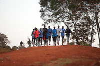 Athletes training with Kenyan elite marathoner Wilson Kipsang run through the town of Iten, Kenya on a morning run in April, 2012. Athletes from around the world have flocked to Kenya in advance of the Olympics to be at the heart of the revolution in running that has seen world records and course records fall by minutes in recent years.