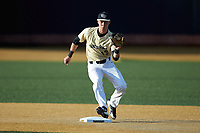 Wake Forest Demon Deacons shortstop Bruce Steel (17) fields a ground ball behind the second base bag against the Liberty Flames at David F. Couch Ballpark on April 25, 2018 in  Winston-Salem, North Carolina.  The Demon Deacons defeated the Flames 8-7.  (Brian Westerholt/Four Seam Images)