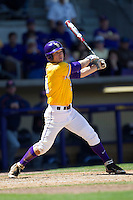 LSU Tigers shortstop Alex Bregman #30 follows through on his swing against the Auburn Tigers in the NCAA baseball game on March 24, 2013 at Alex Box Stadium in Baton Rouge, Louisiana. LSU defeated Auburn 5-1. (Andrew Woolley/Four Seam Images).