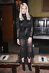Model poses in an outfit from the Veronica Beard Fall 2017 collection on February 13, 2017 at The Jane Hotel in New York City, during New York Fashion Week: Women Fall Winter 2017.