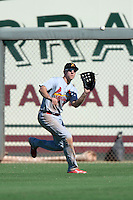 Salt River Rafters outfielder Stephen Piscotty (11), of the St. Louis Cardinals organization, catches a fly ball during an Arizona Fall League game against the Surprise Saguaros on October 14, 2013 at Surprise Stadium in Surprise, Arizona.  Salt River defeated Surprise 3-2.  (Mike Janes/Four Seam Images)