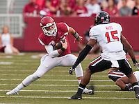 NWA Democrat-Gazette/BEN GOFF @NWABENGOFF<br /> Brandon Allen, Arkansas quarterback, runs the ball as Keenon Ward, Texas Tech safety, defends in the first quarter on Saturday Sept. 19, 2015 during the game in Razorback Stadium in Fayetteville.