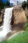 Waterfall with rainbow in foreground, Yosemite National Park, California