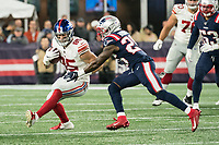 FOXBORO, MA - OCTOBER 10: New York Giants Tight end Rhett Ellison (85) stepping to avoid New England Patriots Defensive back Terrence Brooks (25) during a game between New York Giants and New England Patriots at Gillettes on October 10, 2019 in Foxboro, Massachusetts.
